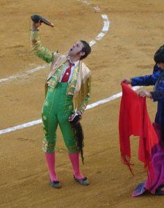 bullfighter-drinking-from-a-bota-236x300